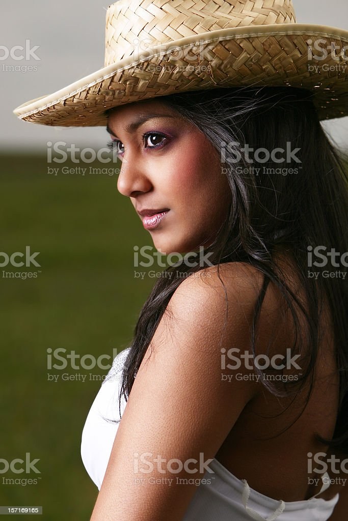 Side Profile Of Young Ethnic Girl In Hat. royalty-free stock photo