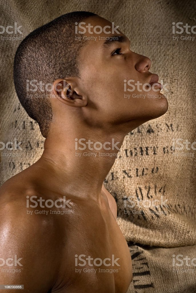Side Profile Portrait of Young Man Looking Up royalty-free stock photo