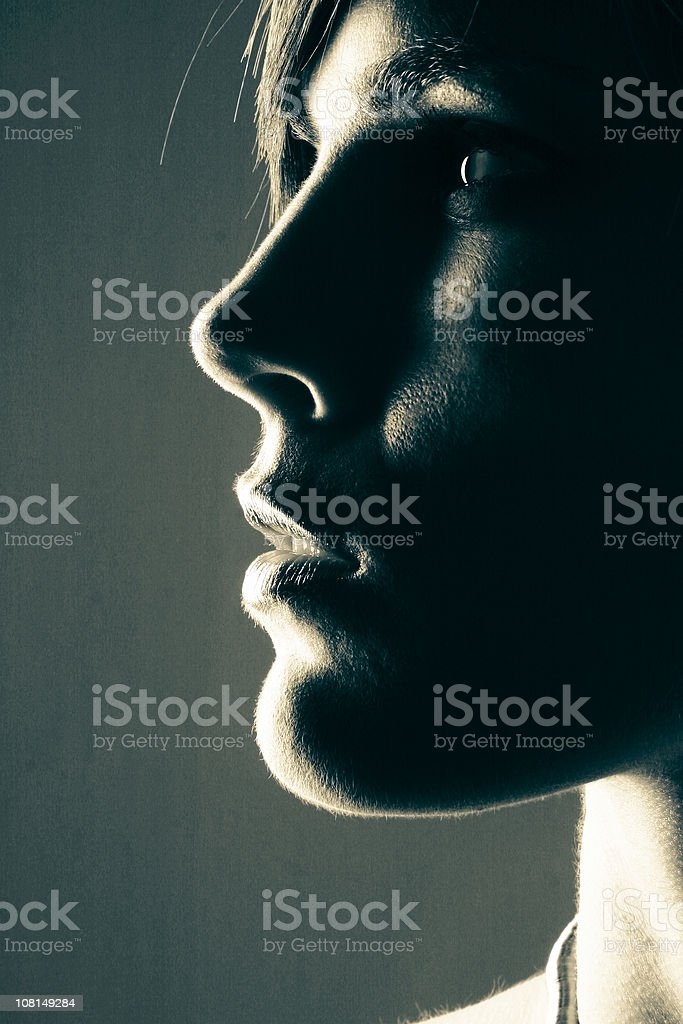 Side Profile Portrait of Young Woman, Low Key Toned stock photo