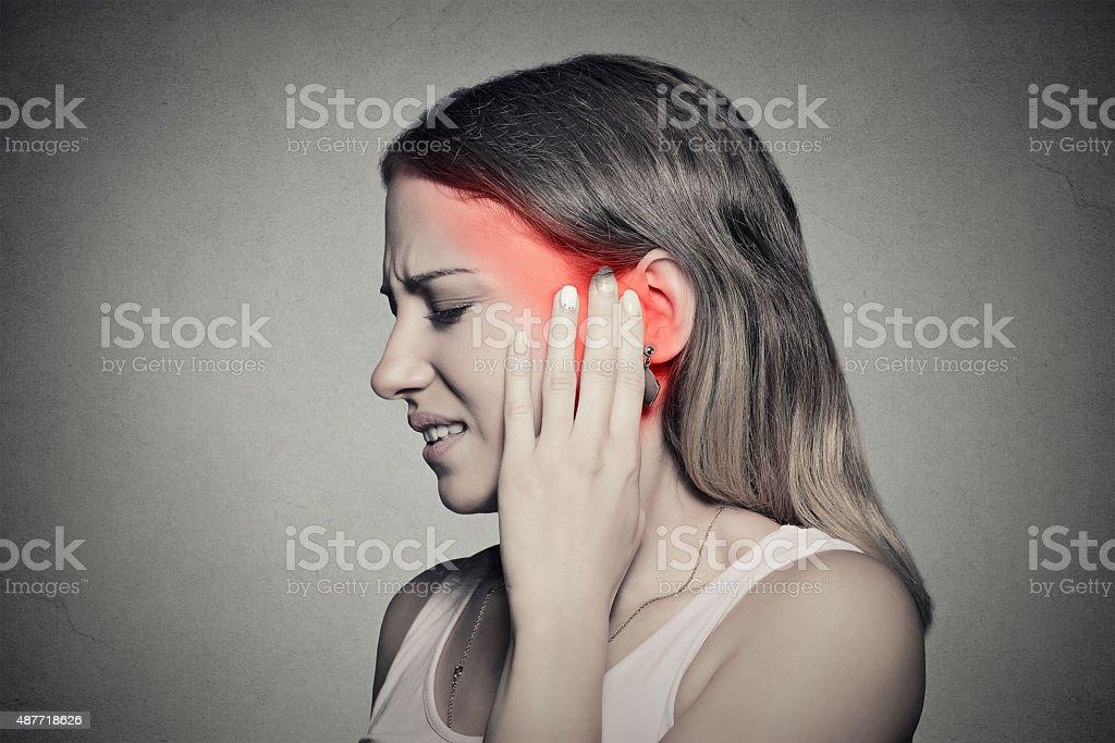 side profile sick female having ear pain touching head stock photo