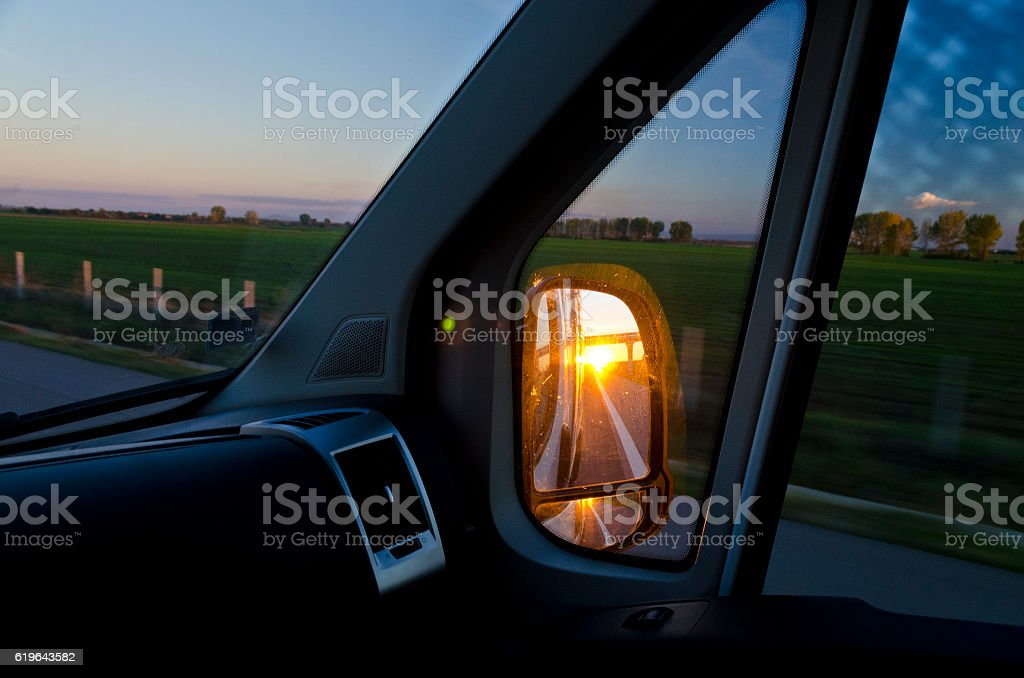 Side rear-view mirror in the evening stock photo