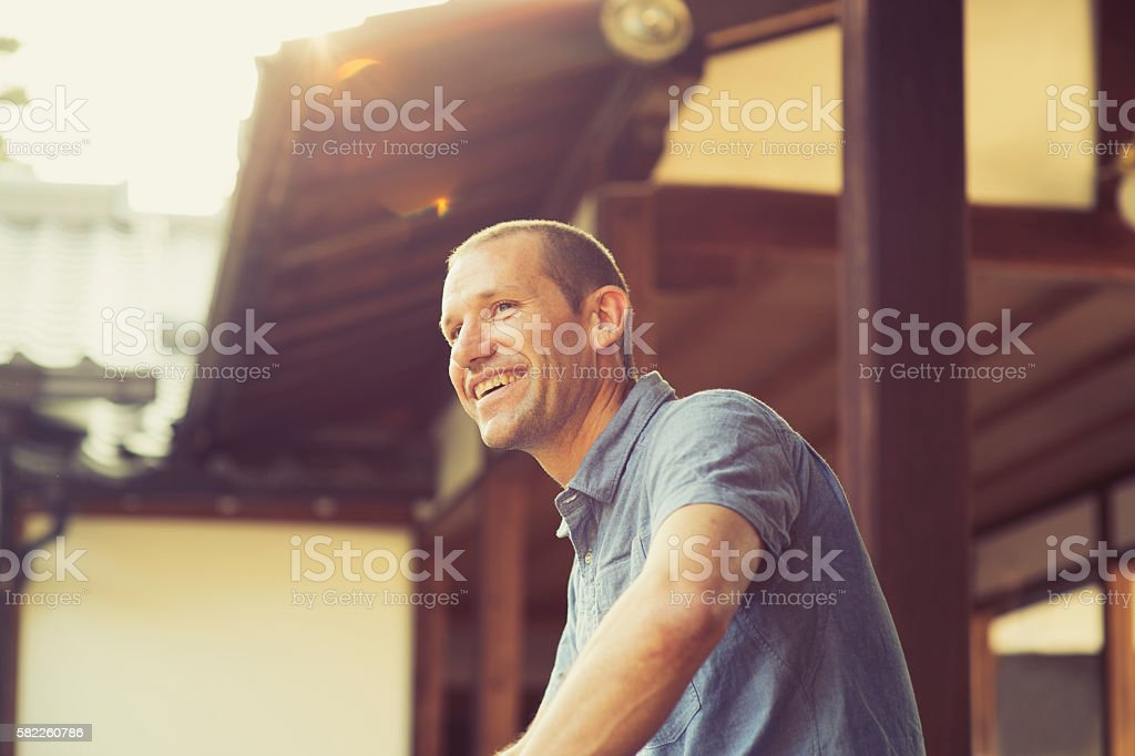 Side shot of man in a Japanese temple stock photo