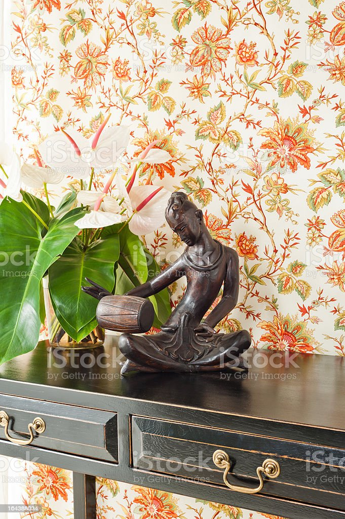 Side table with flowers and interior decoration royalty-free stock photo