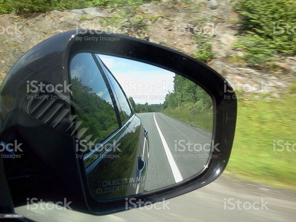 Side View Car Mirror Reflecting The Road Behind stock photo