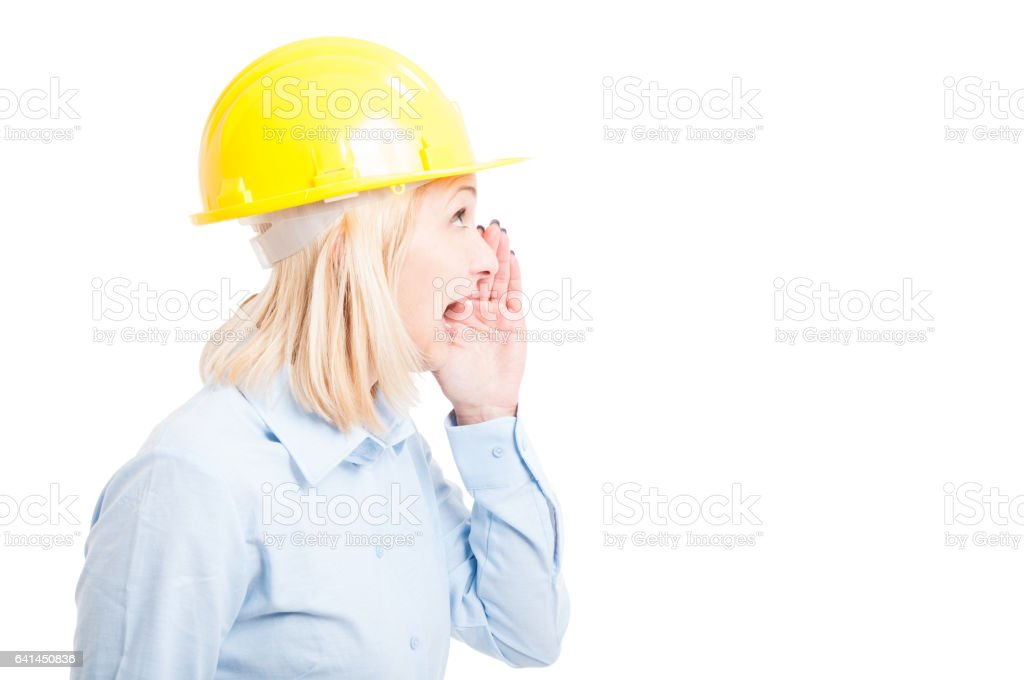 Side view female architect making shouting gesture stock photo