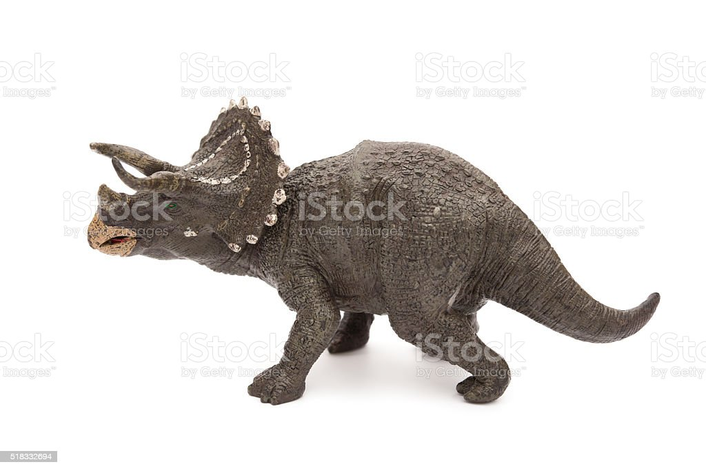 side view grey triceratops toy on a white background stock photo