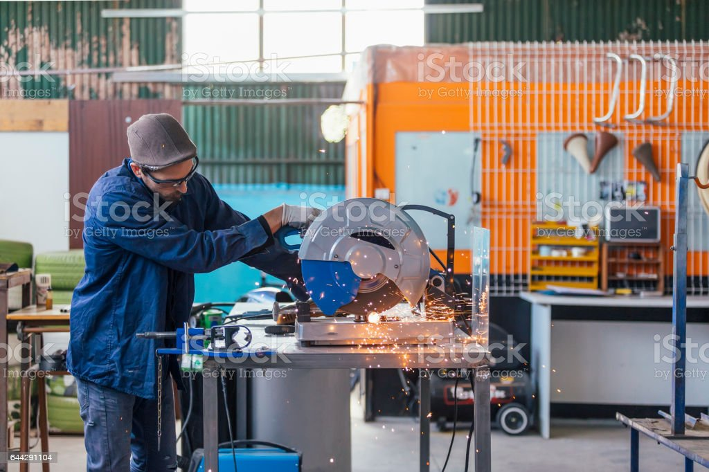 Side view man working with saw machine stock photo