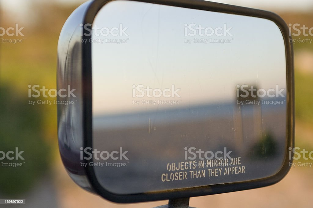 Side view mirror with legend OBJECTS IN MIRROR ARE CLOSER. stock photo