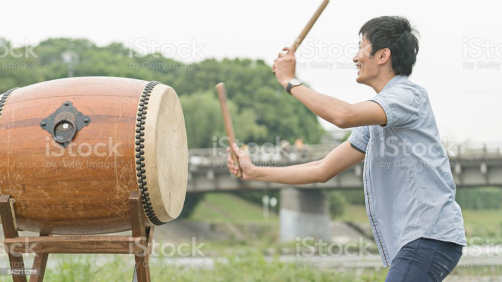 Side view od a man playing Japanese drum stock photo
