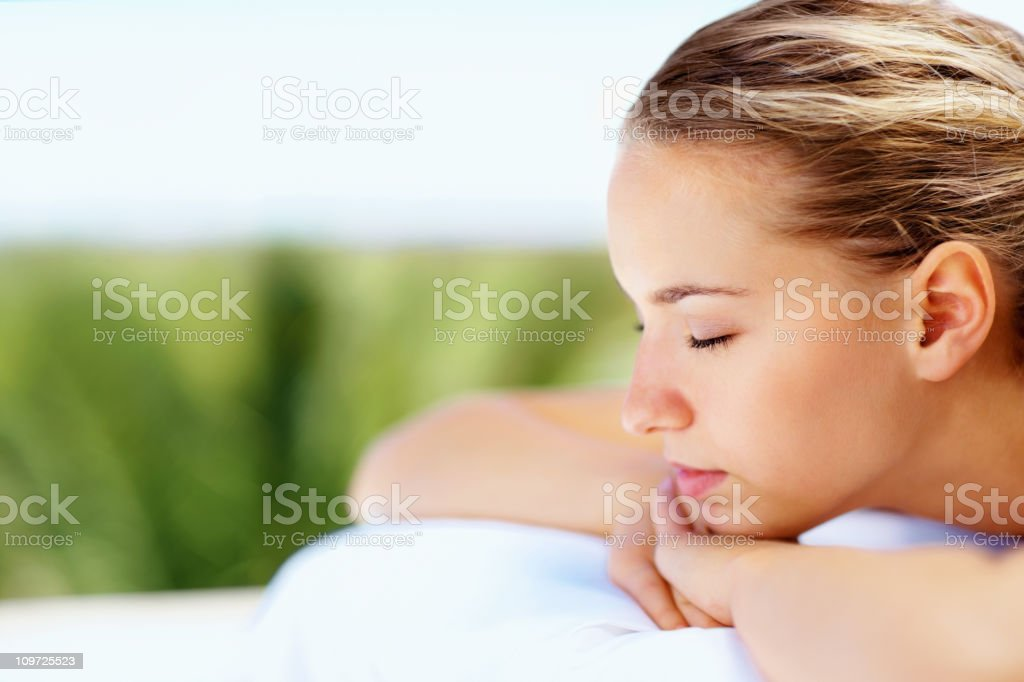 Side view of a beautiful lady relaxing at spa royalty-free stock photo