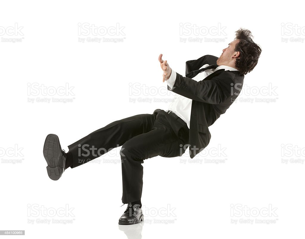 Side view of a businessman falling down stock photo