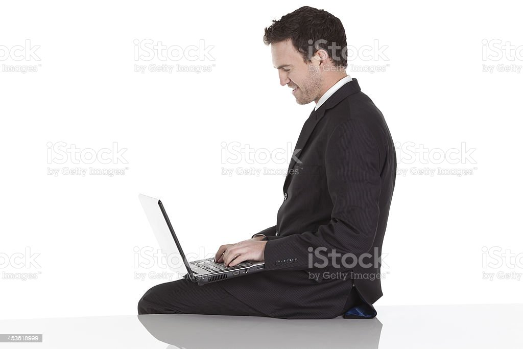 Side view of a businessman using laptop royalty-free stock photo