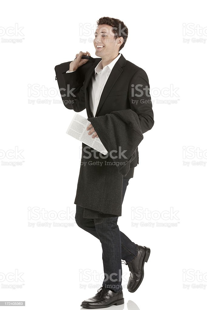 Side view of a businessman walking royalty-free stock photo