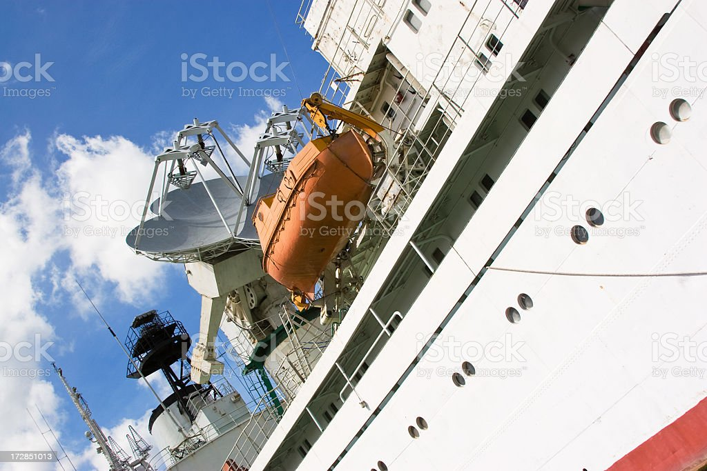 Side view of a cruise ship with lifeboat on the side. stock photo