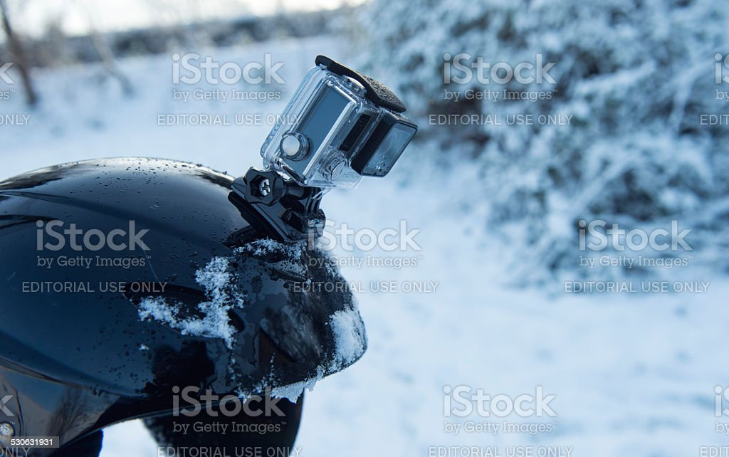 Side view of a GoPro action camera on helmet stock photo