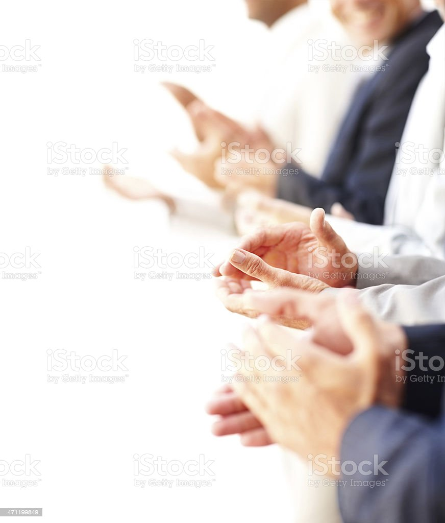 Side view of a group of business colleagues clapping hands stock photo