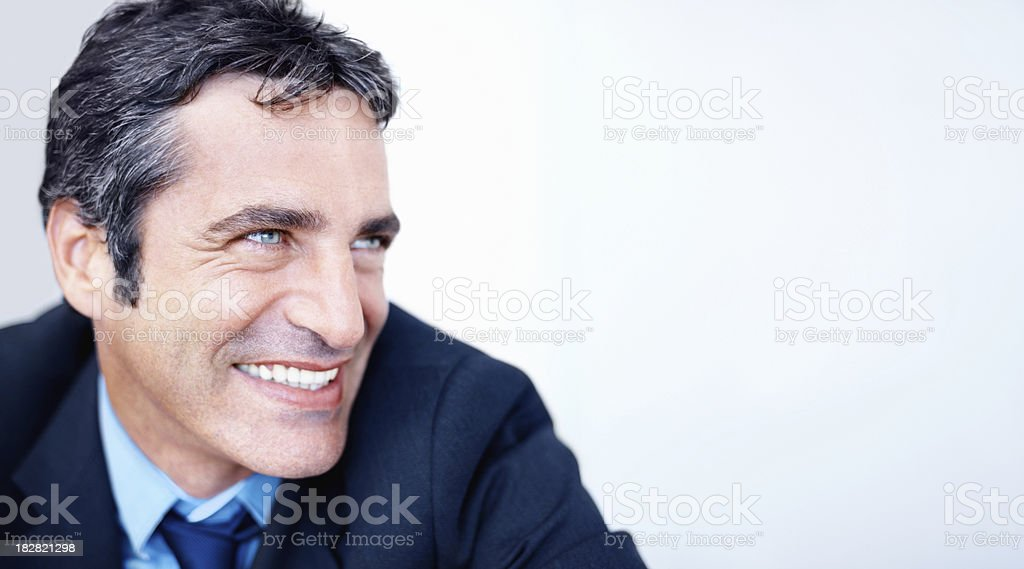 Side view of a happy businessman looking at copy space royalty-free stock photo