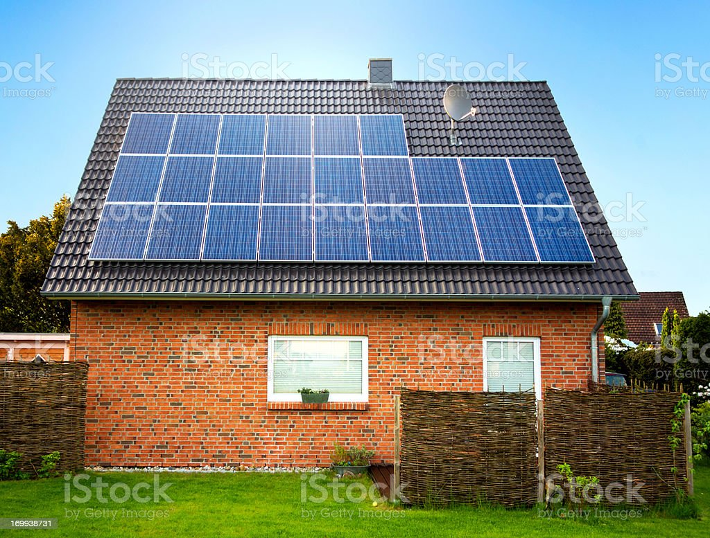 Side view of a large solar panel on a rooftop stock photo