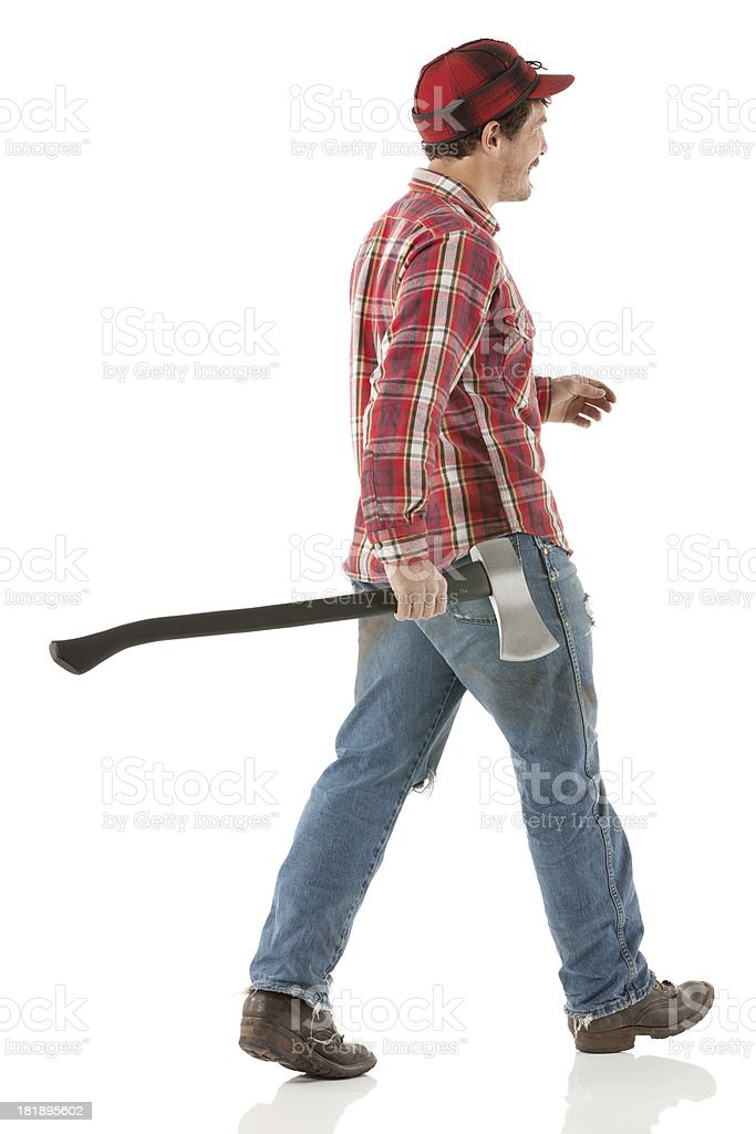 Side view of a lumberman walking with an axe royalty-free stock photo
