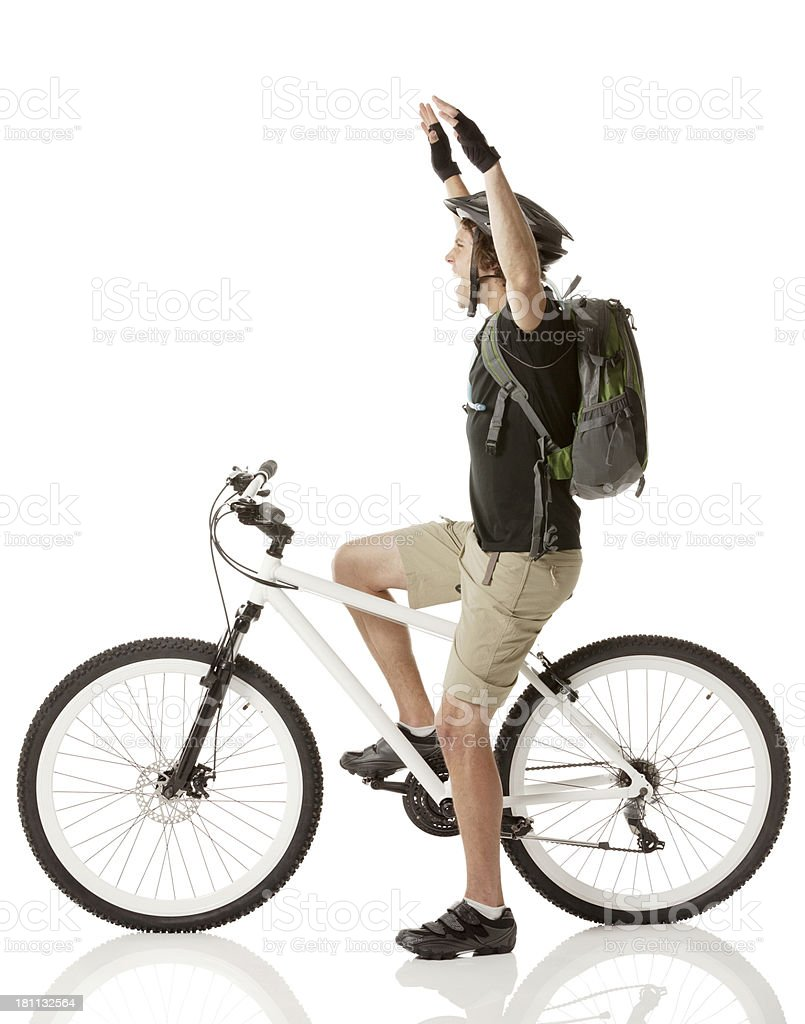 Side view of a male cyclist celebrating his success royalty-free stock photo