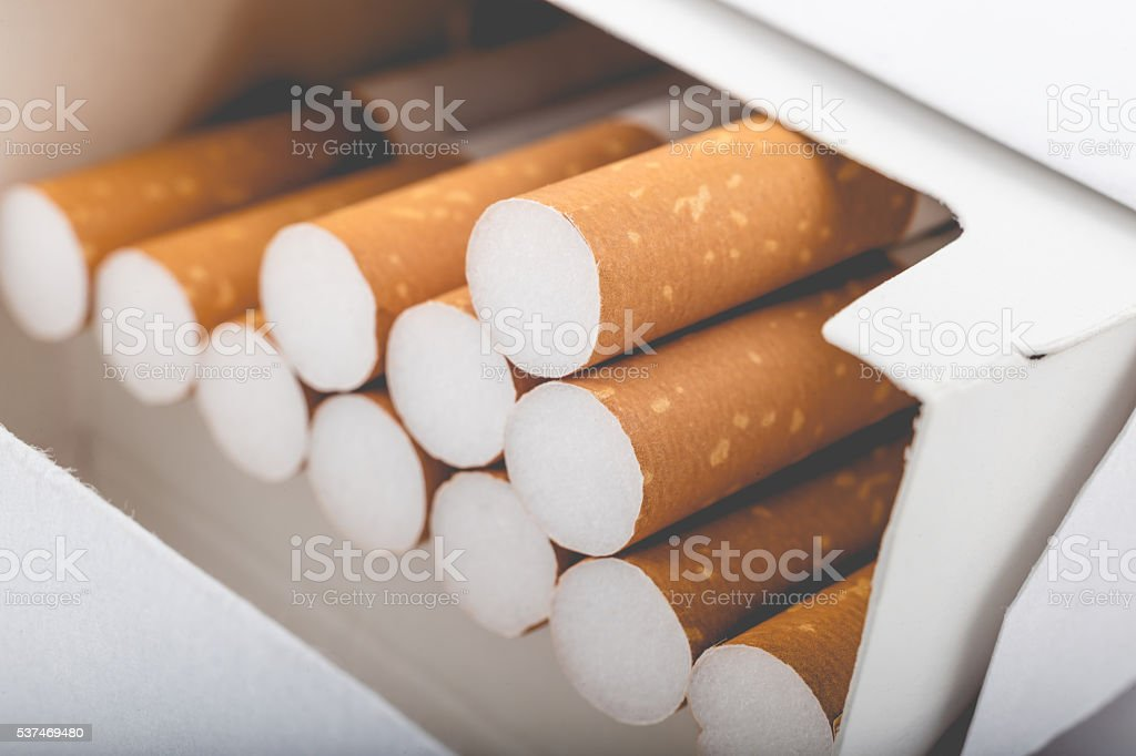 Side view of a pack of cigarettes with faded filter stock photo