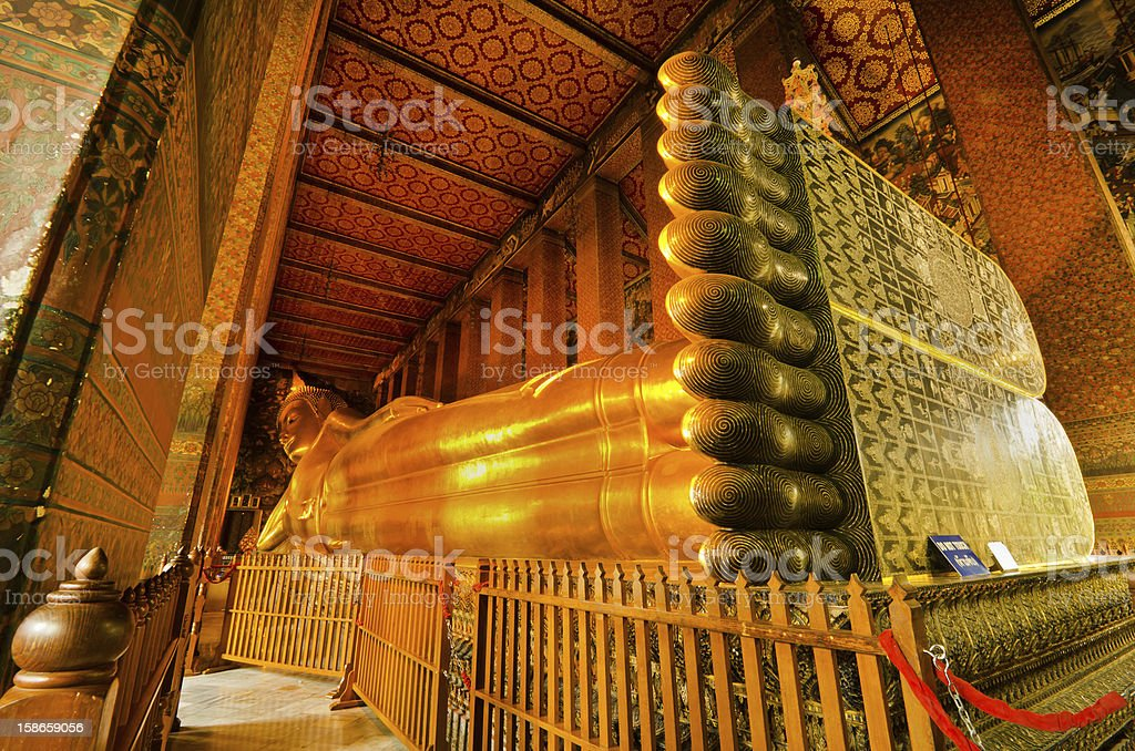 A side view of a reclining golden Buddha stock photo