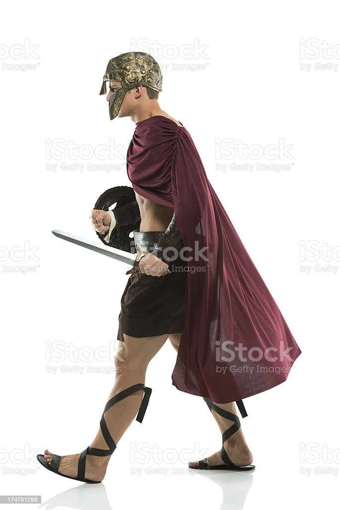 Side view of a spartan walking royalty-free stock photo
