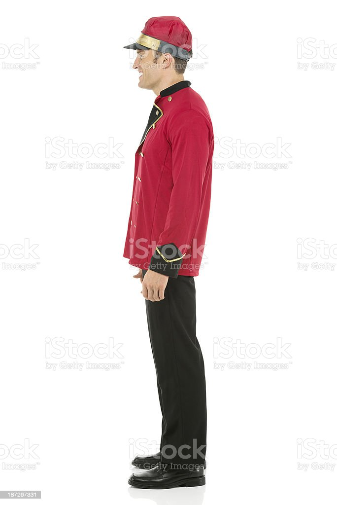 Side view of a valet standing royalty-free stock photo