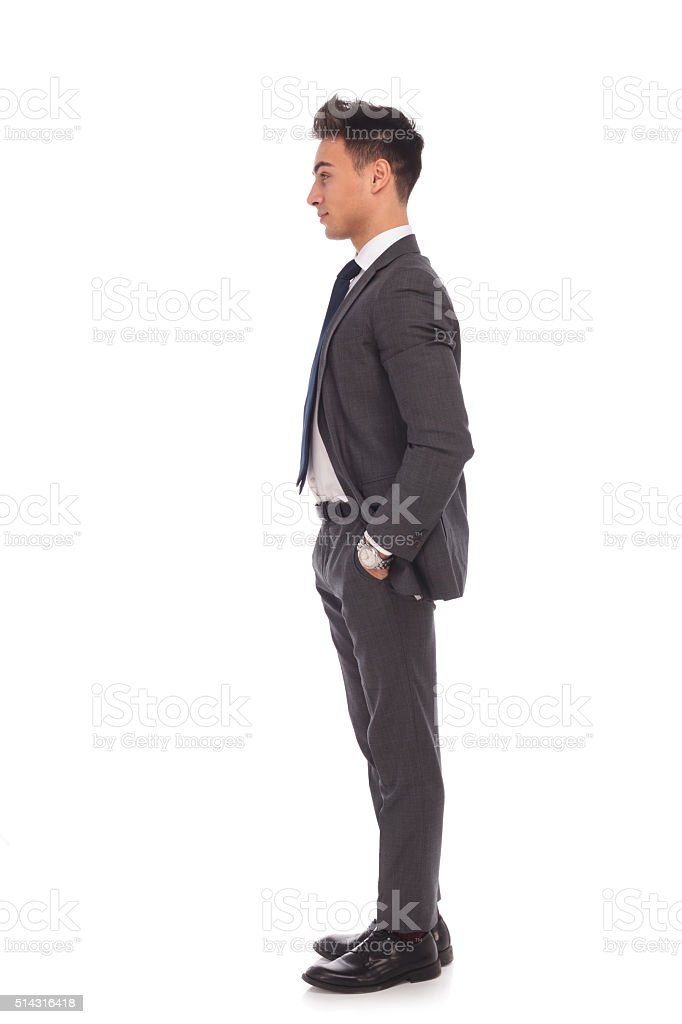 side view of a young business man standing in line stock photo