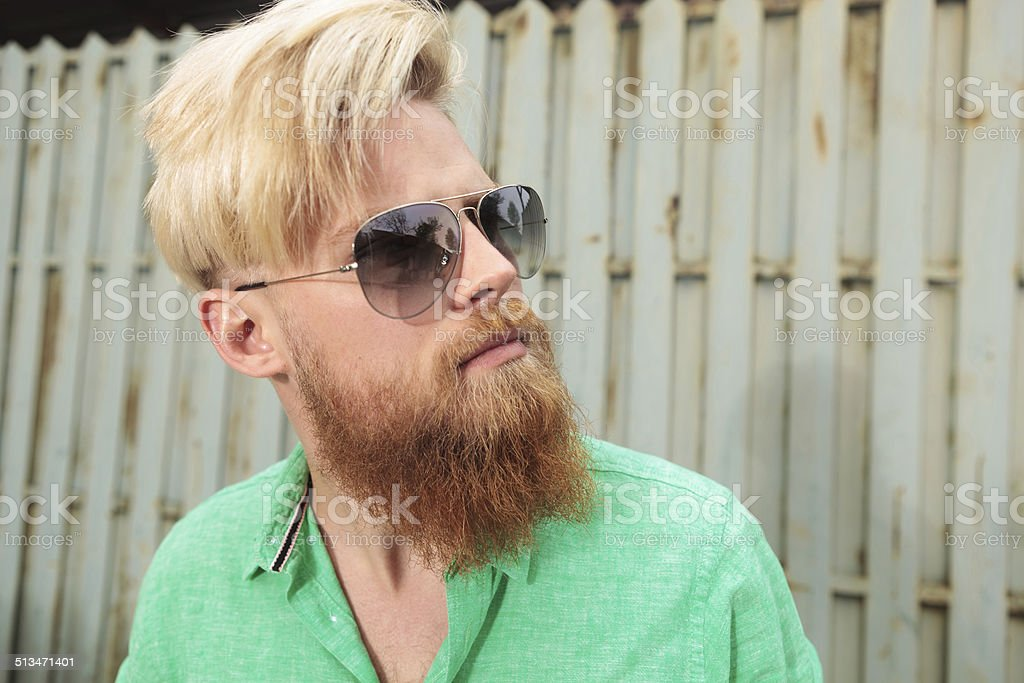 side view of a young man with beard stock photo