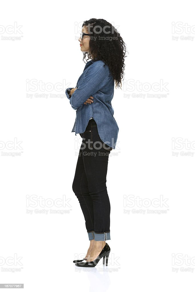 Side view of a young woman standing stock photo
