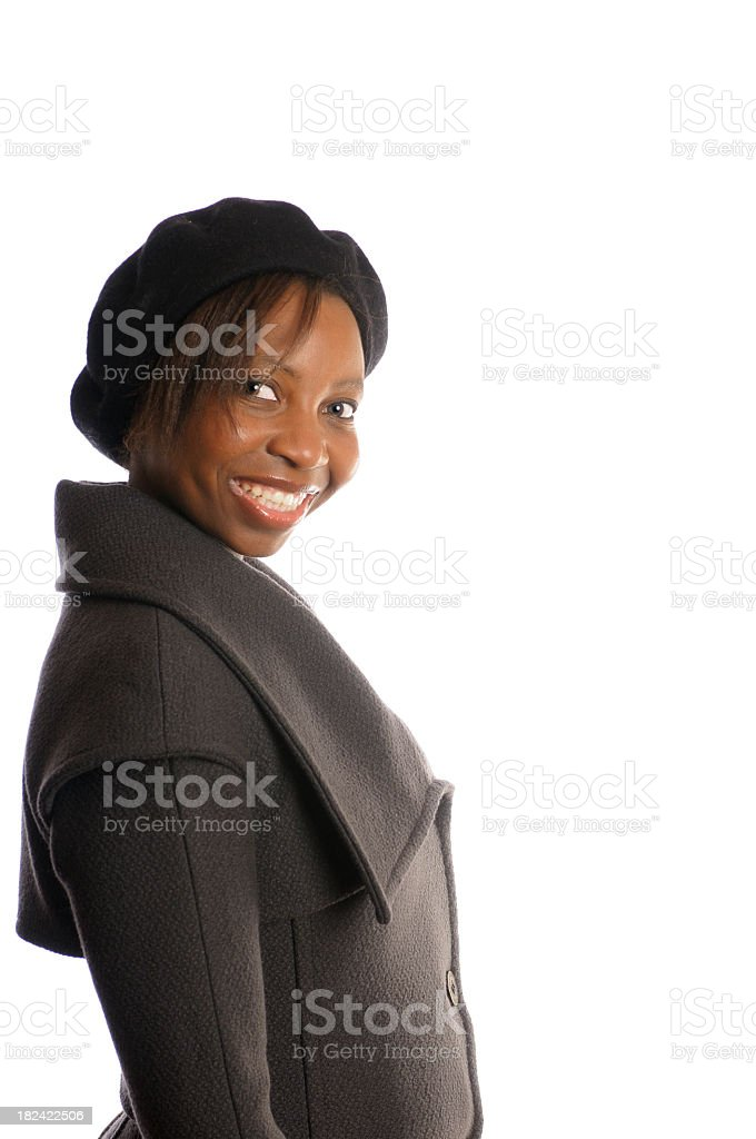 Side View of African American Woman in Winter Coat stock photo