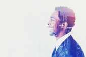 Side view of African businessman, looks forward