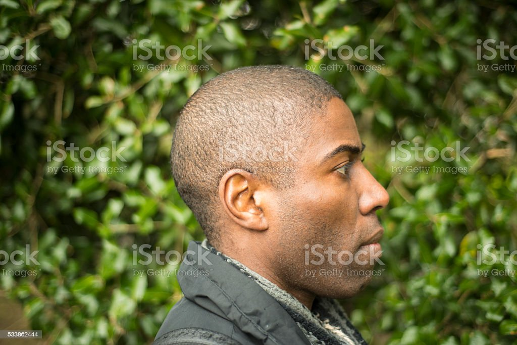 Side view of an African Brazilian man in park stock photo