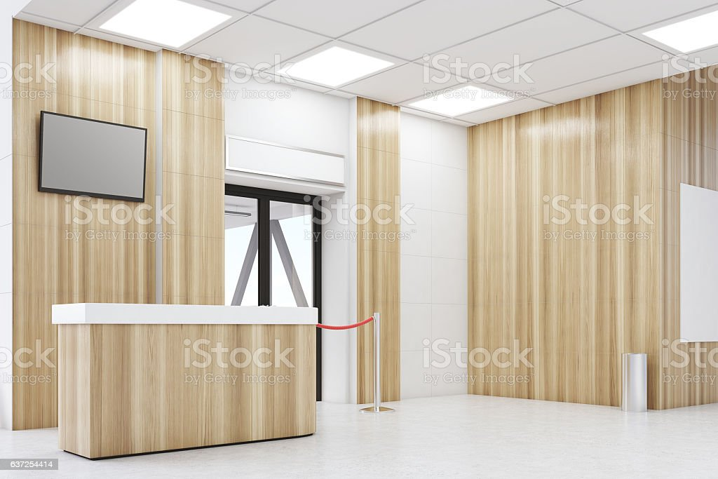 Side view of an airport lobby with poster stock photo