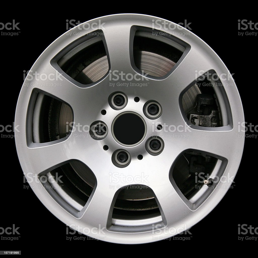 Side view of an alloy car wheel, isolated on black stock photo