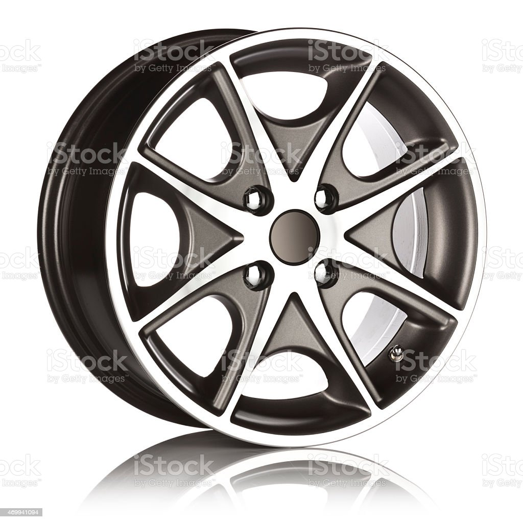 Side view of an alloy wheel on reflective white backdrop stock photo
