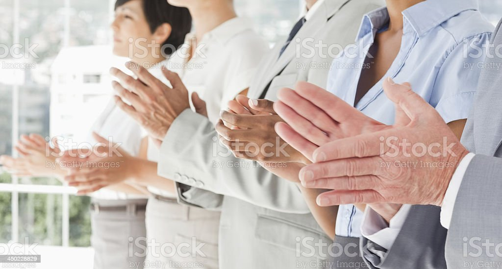 Side view of applauding hands stock photo
