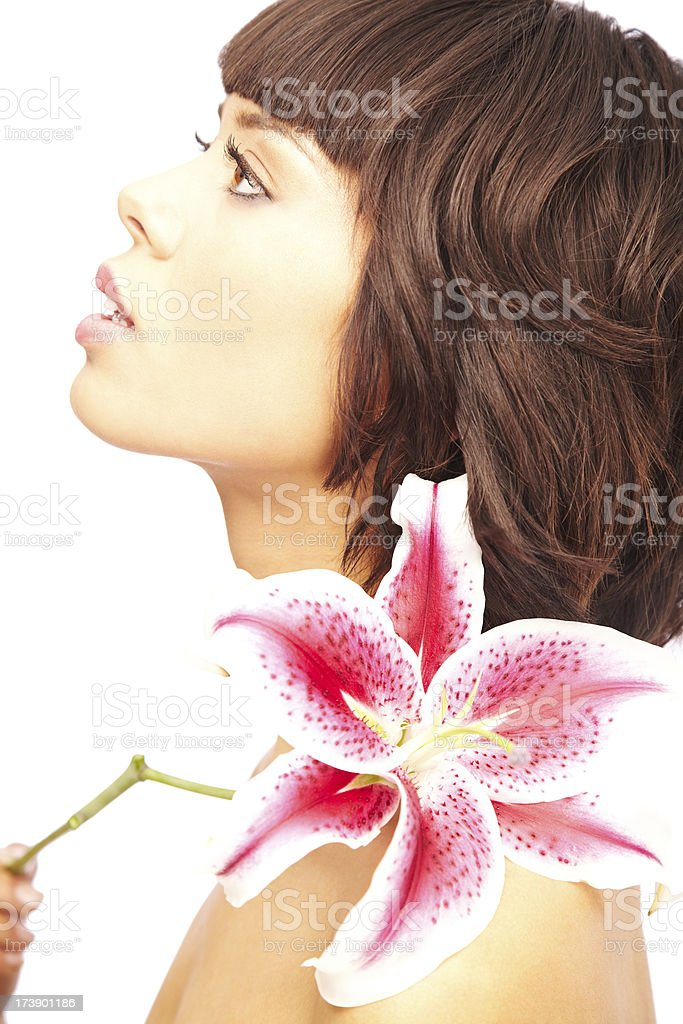 Side View of Attractive Young Brunette with a Stargazer Lily stock photo
