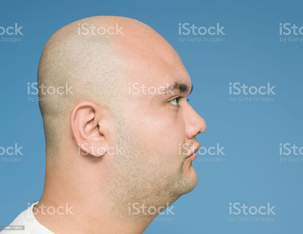Side view of bald head stock photo