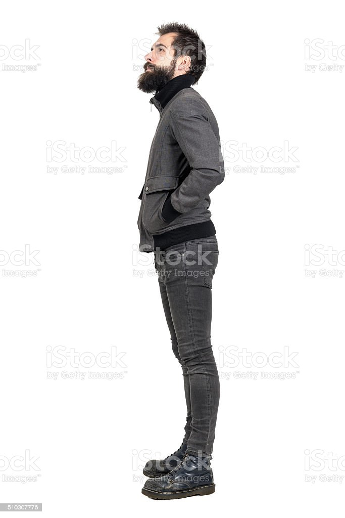 Side view of bearded punker in army boots looking up stock photo