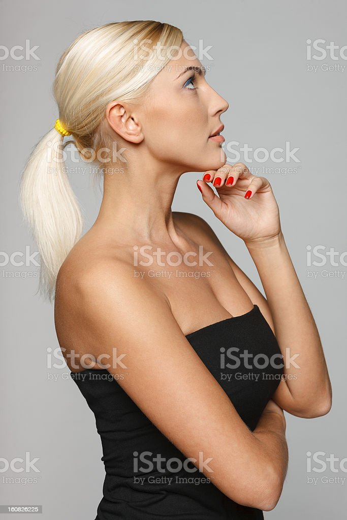 Side view of beautiful woman with hand on chin royalty-free stock photo