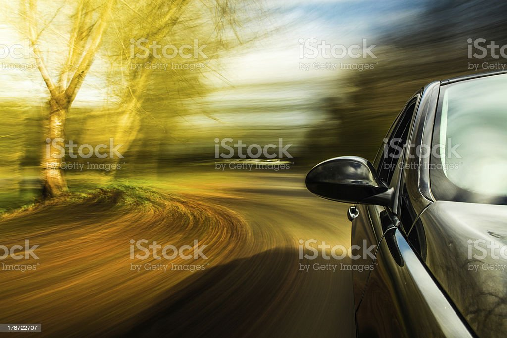 Side view of black car in turn. royalty-free stock photo