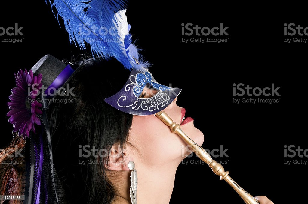 Side view of black haired beauty in blue mask. stock photo