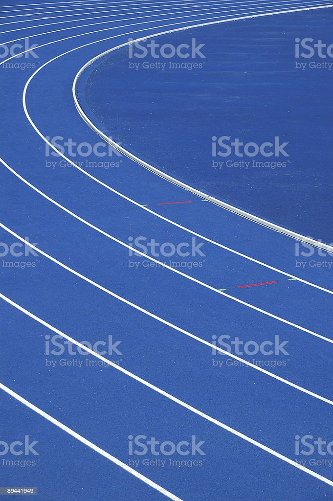 Side view of blue running track stock photo