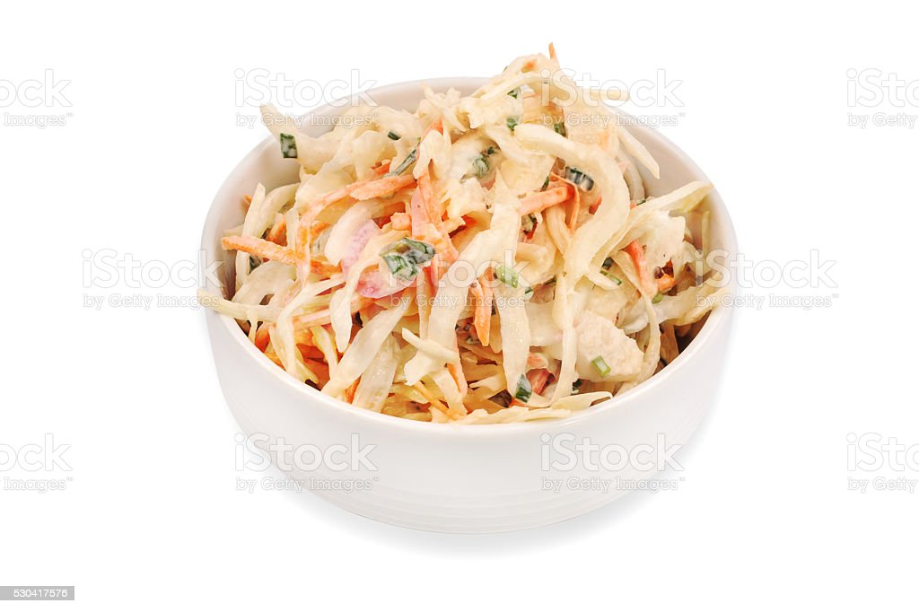 Side view of  bowl filled with coleslaw isolated on  white stock photo