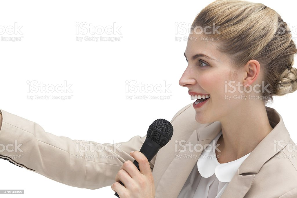 Side view of businesswoman with microphone royalty-free stock photo