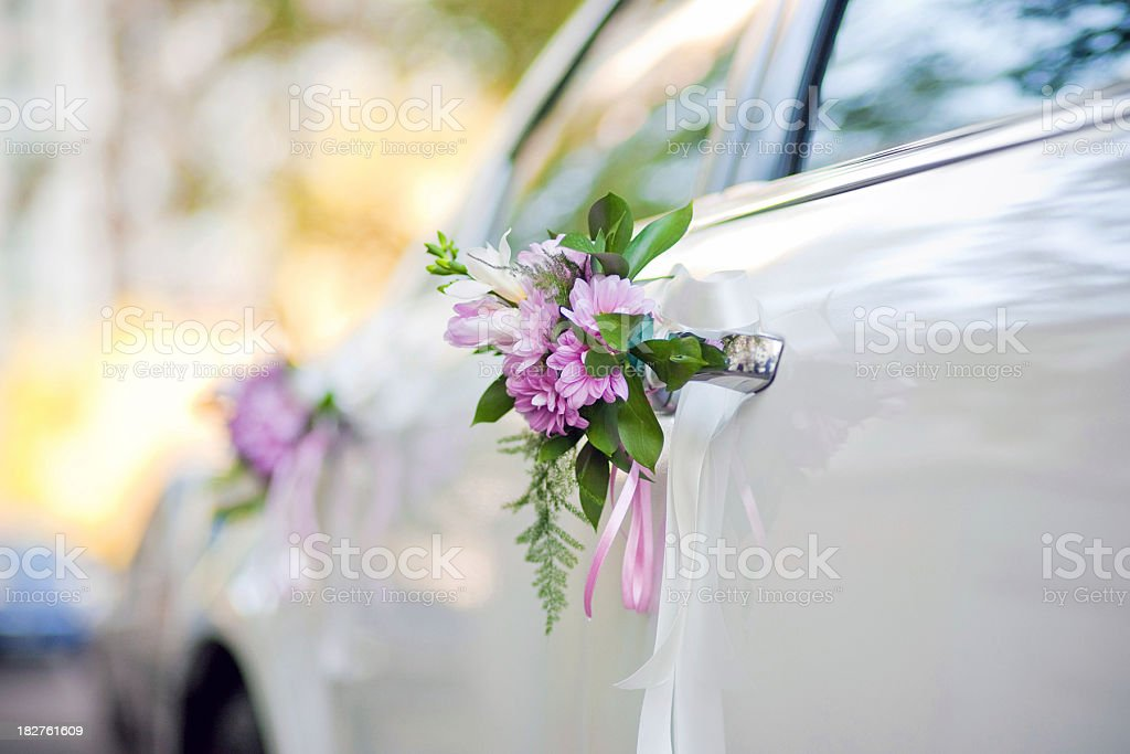 Side view of car decorated with purple flowers for a wedding stock photo