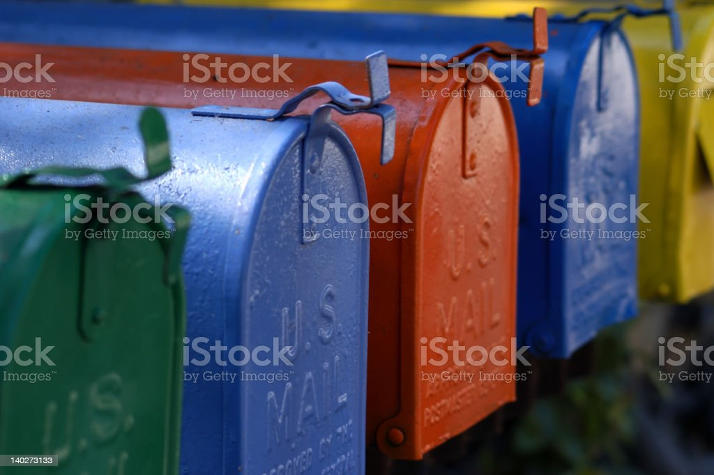 Side view of colored mailboxes stock photo
