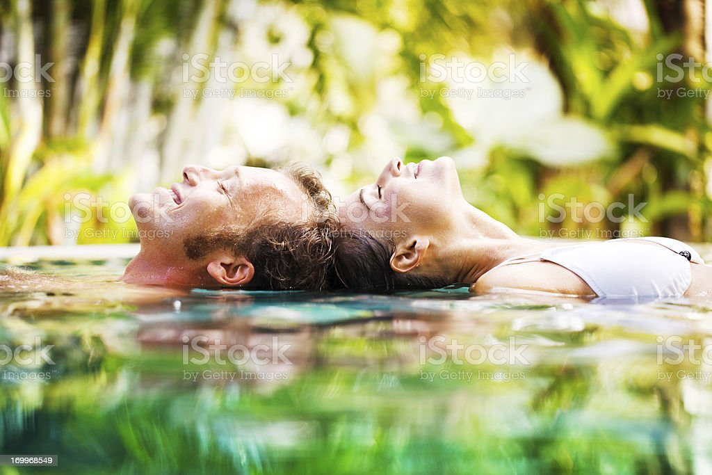 Side view of couple in the pool. royalty-free stock photo
